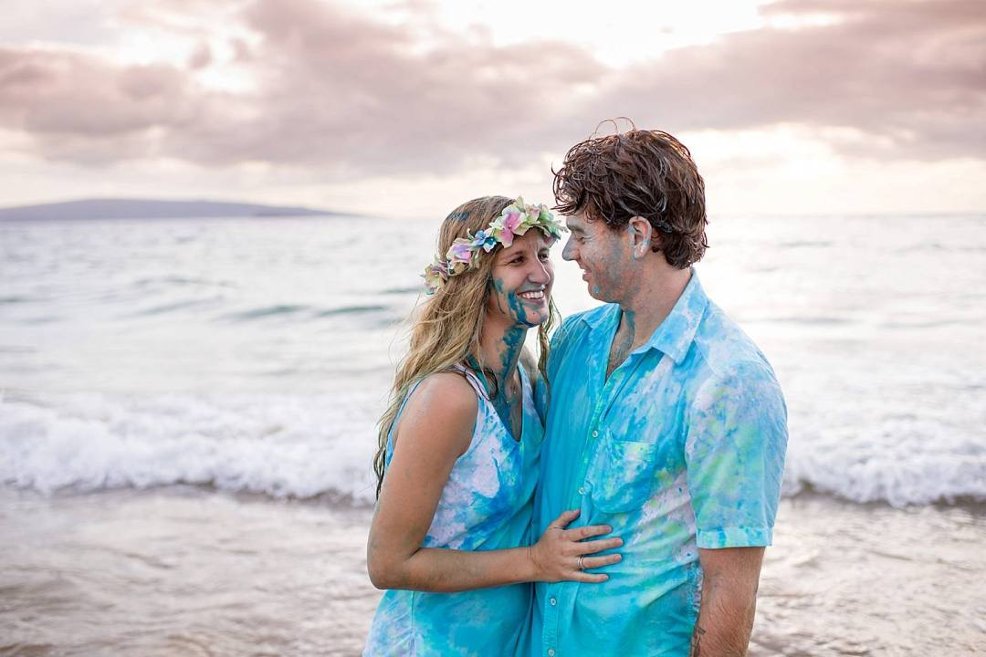 Couple on the beach in Maui after gender reveal