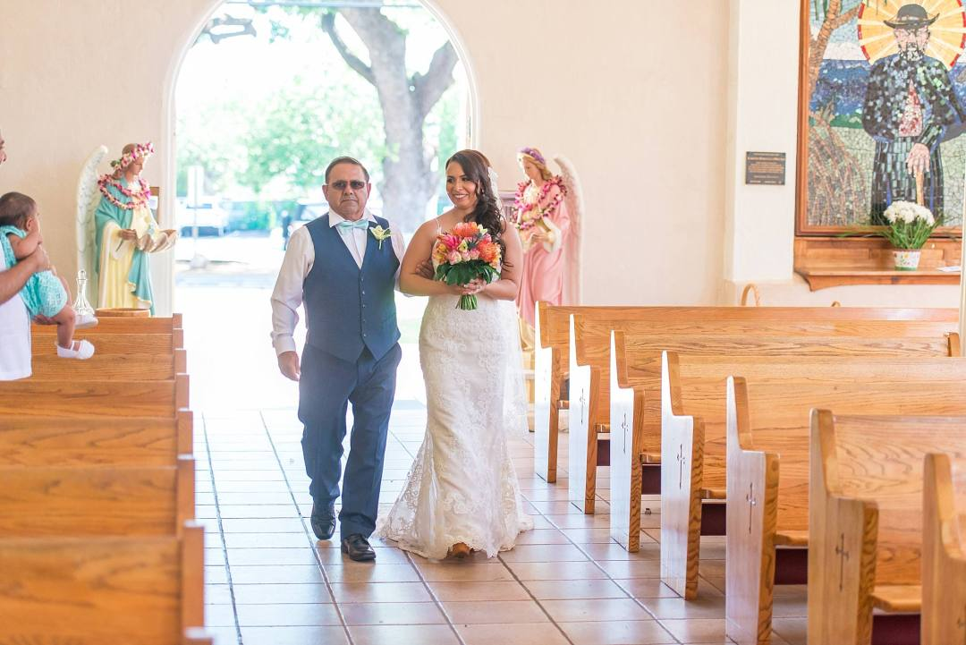 bride walking down aisle at Maria lanakila