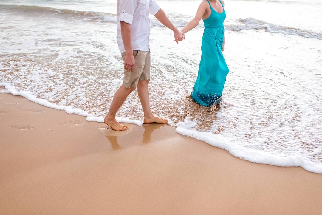 walking on the beach in maui, hawaii