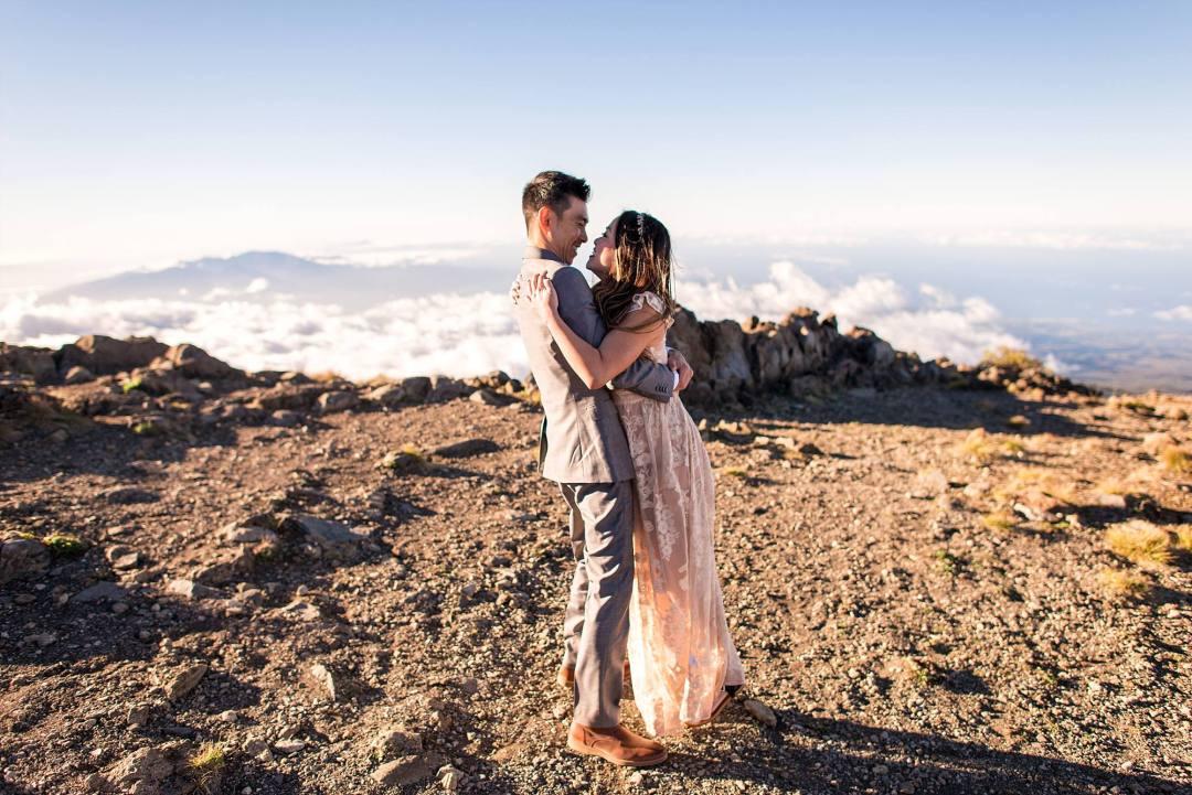 bride adn groom hugging on top of haleakala