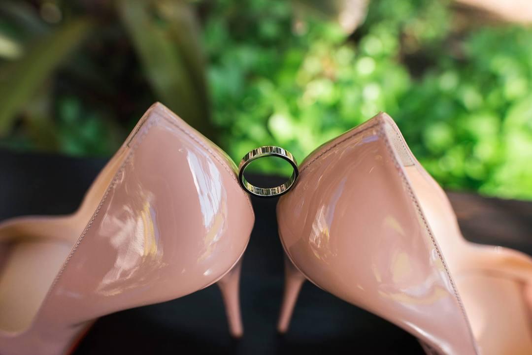nude high heel shoes and groom's wedding ring