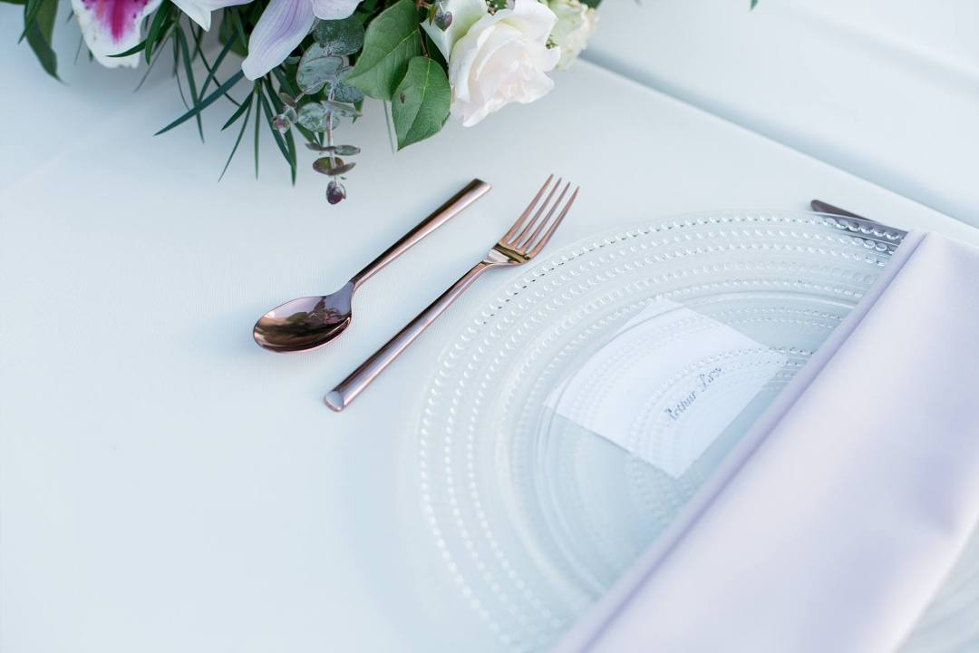 place setting for wedding, glass plate and silverware