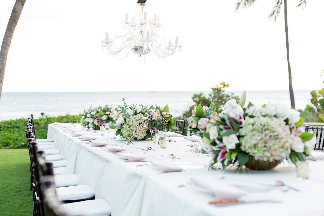 long farm table wedding set up with incredible centerpieces on Maui