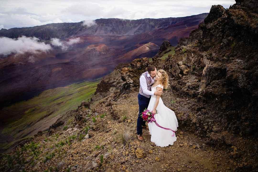 couple kissing by halekala crater