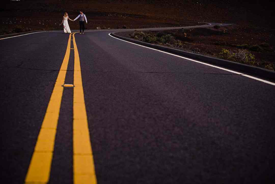 bride and groom on a road in maui