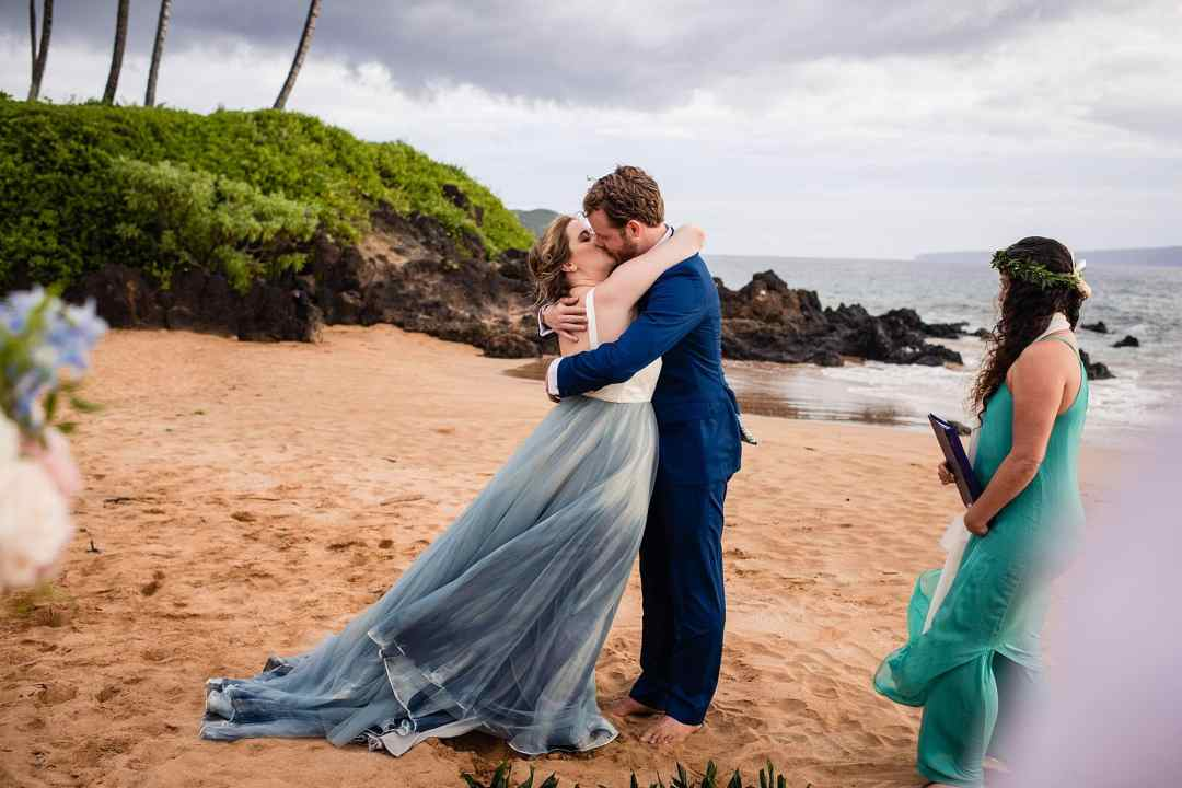 first kiss at beach wedding