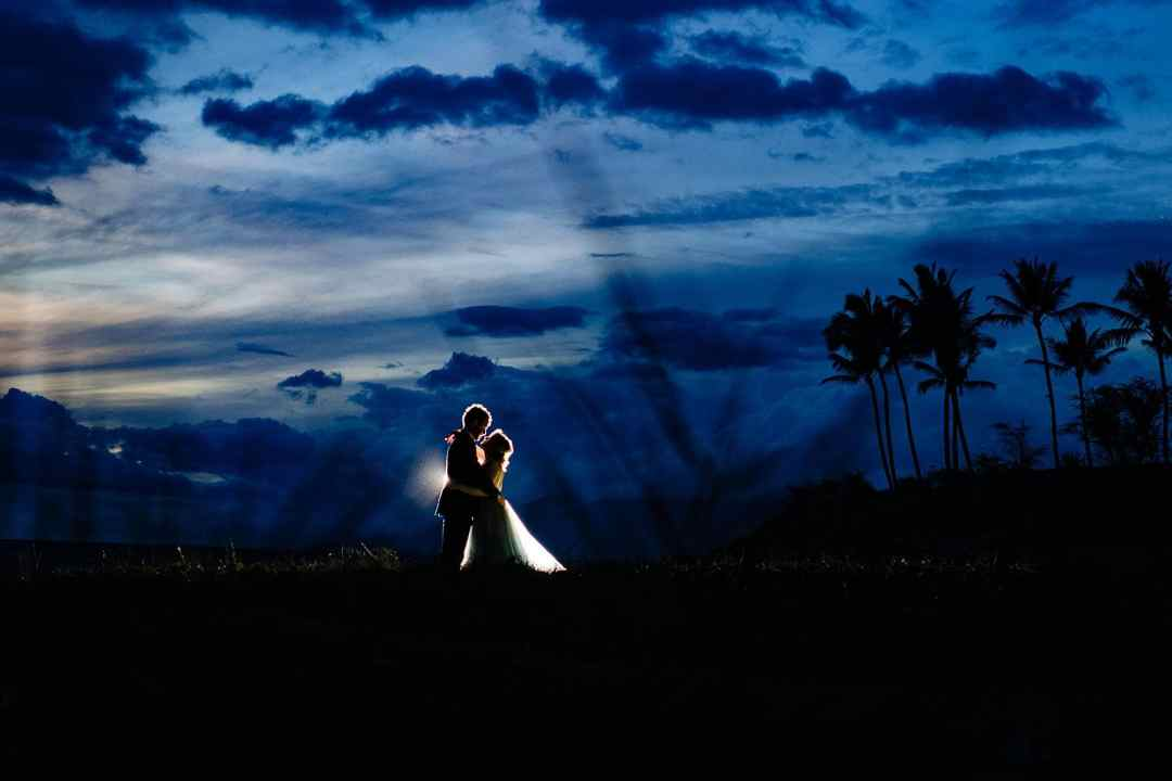 bride and groom with light behind them