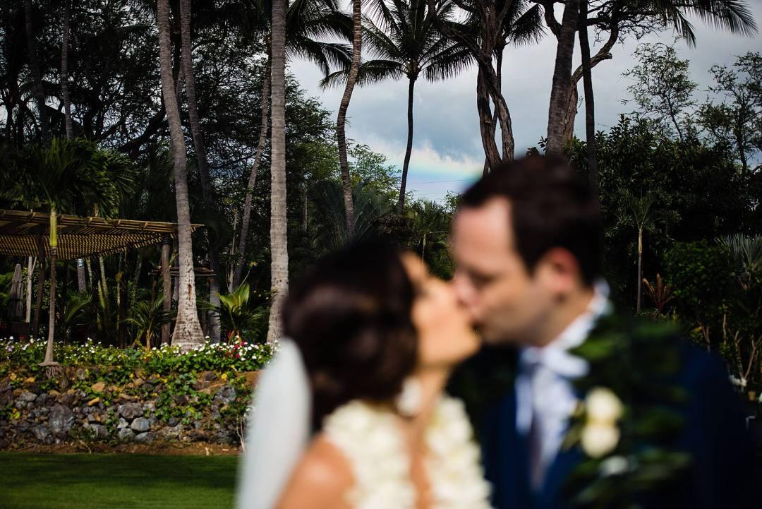 bride and groom with rainbow at ponomakena sanctuary