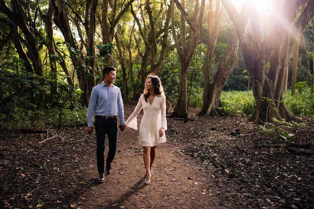 couple walking in jungle in maui