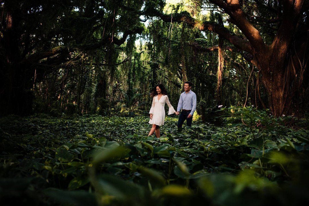 couple walking through the jungle in Maui