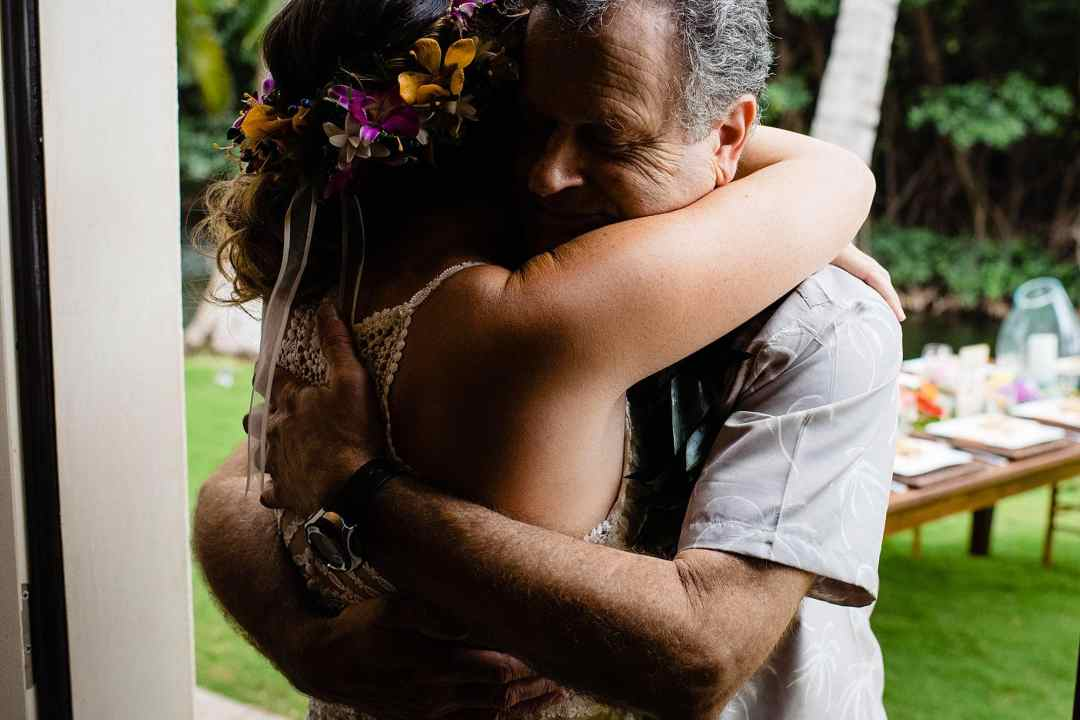 father daugther big hug on wedding day