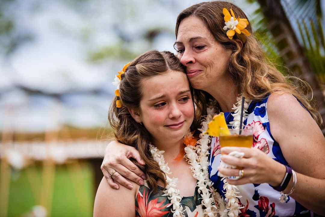emotional photo of bride's sister and niece