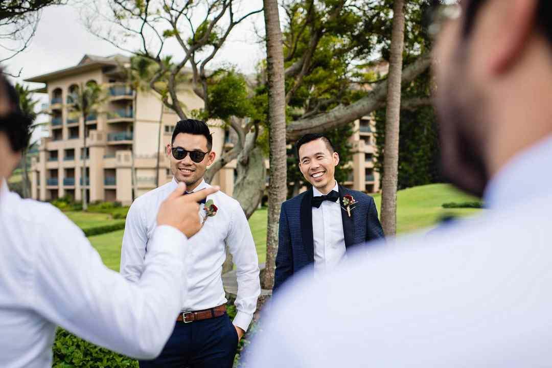 candid photo of groom with groomsmen