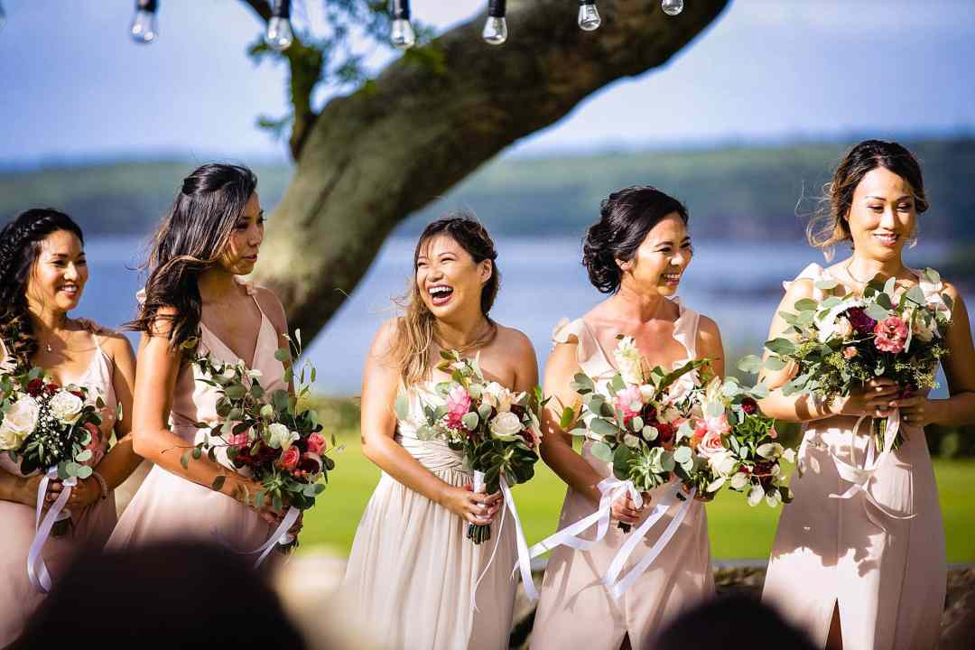 bride laughing at vows during wedding ceremony
