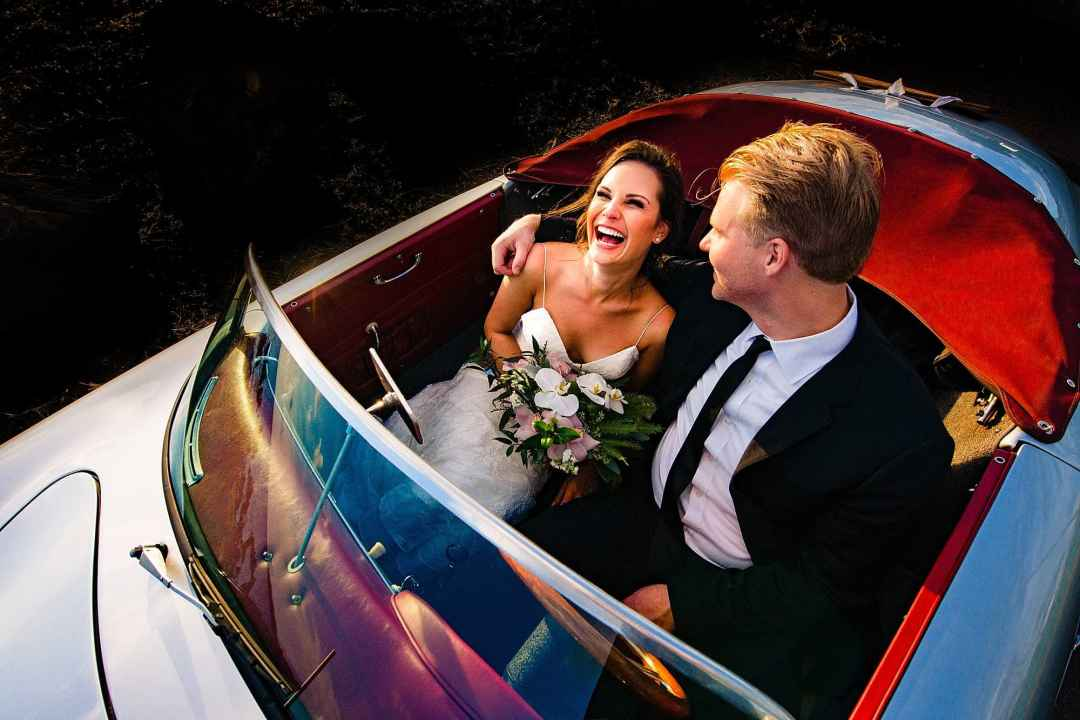 Bride and groom with Maui roadster