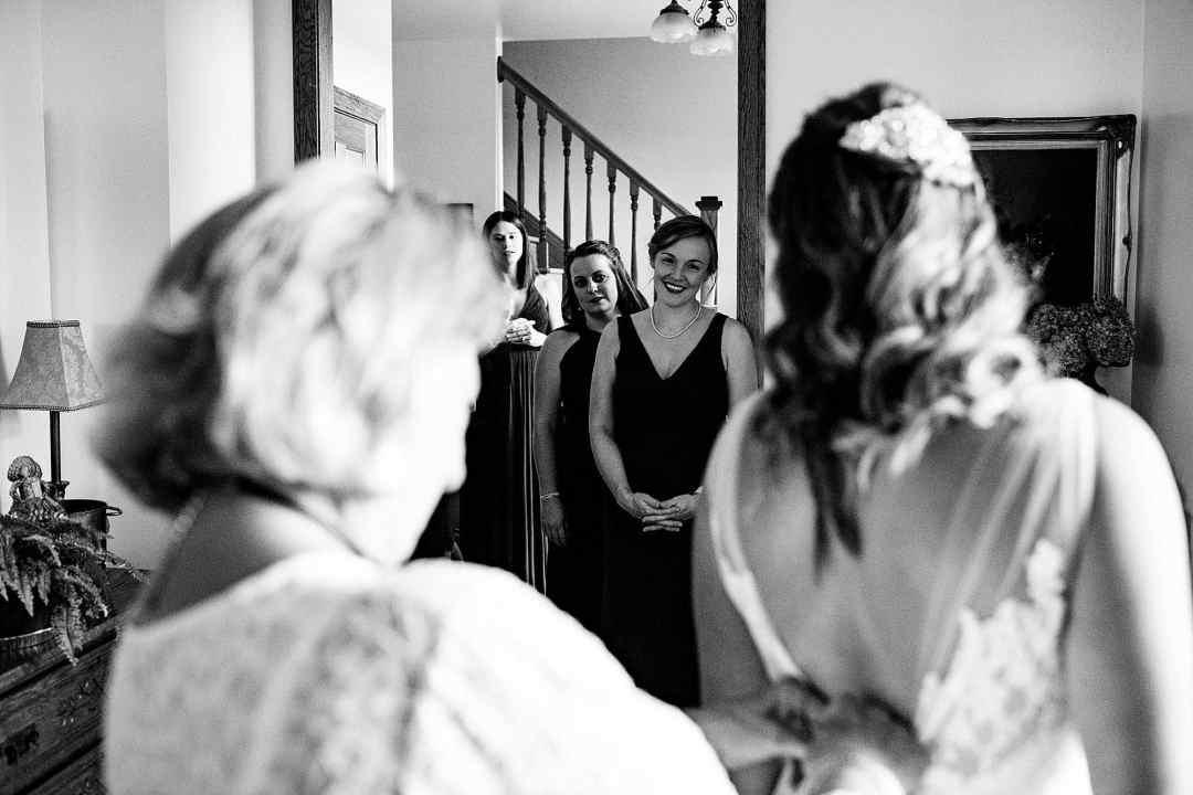 bridesmaids looking at bride