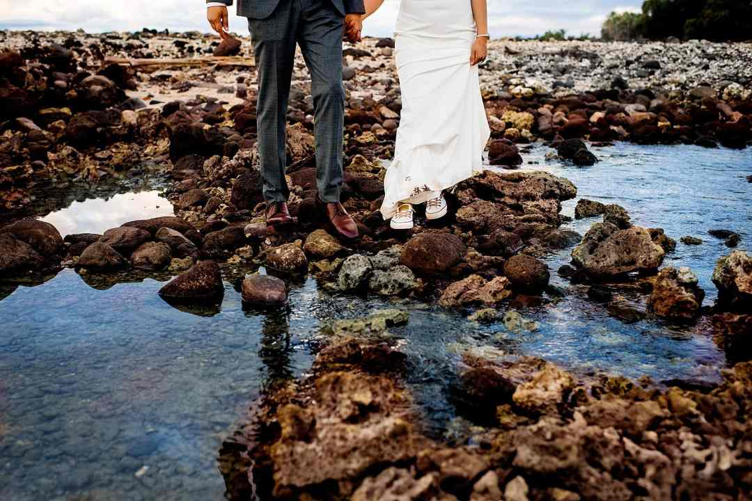 bride wears chuck taylors under her dress at olowalu plantation house