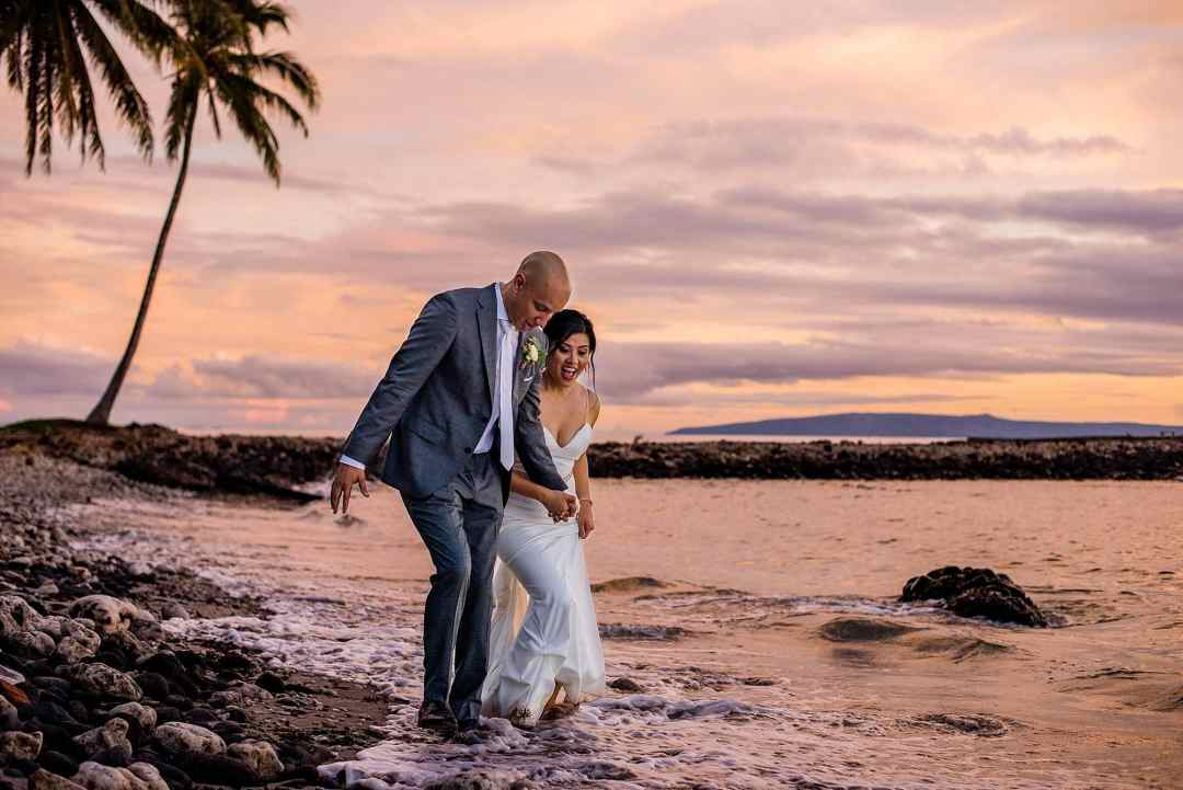 bride and groom getting feet wet at olowalu plantation house