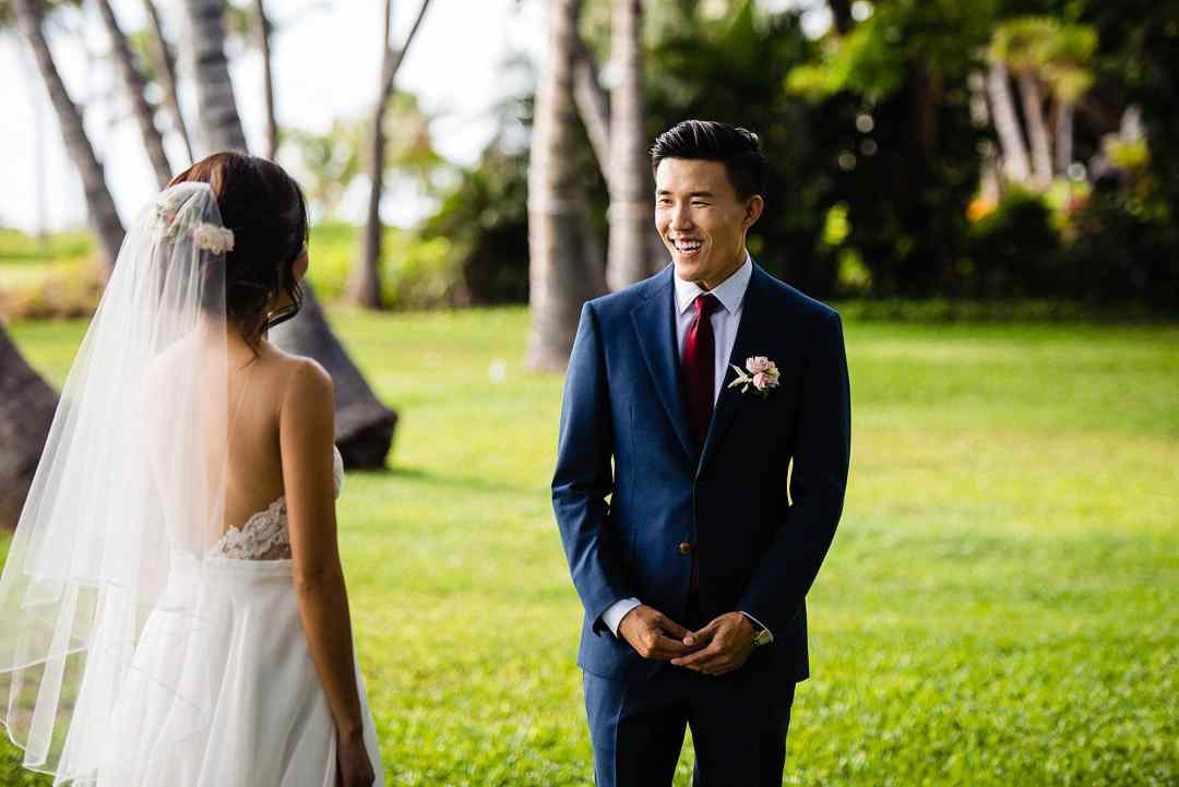 groom reacts to bride at Olowalu Plantation House