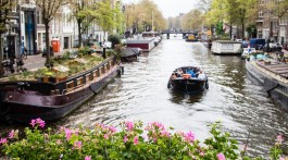 Boat putting through Amsterdam canal