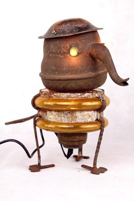 Ambrivre. Sculpture assemblage Cuivre, verre et acier. Composition:théière, lampe à huile, pavillon.