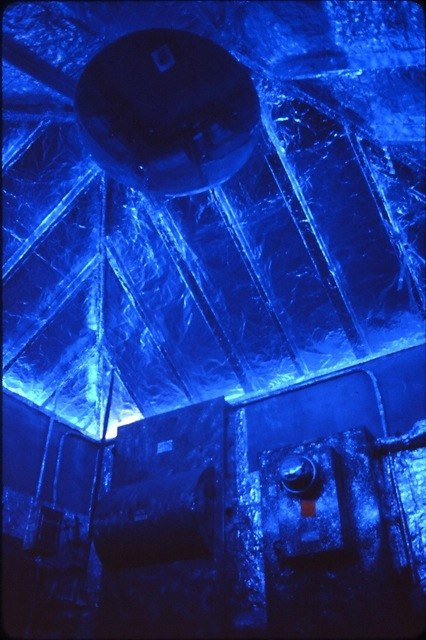 Blue plexiglas filters the natural light as it enters under the eaves.