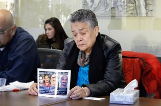 """Doña Mari displays photos of her four disappeared sons without whom she says she is """"dead in life."""""""