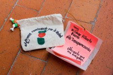 """Women Wallking for Truth member Luz Elena Galeano Laverde hand made pouches containing """"notes from the disappeared"""" for distribution at an event commemorating Operation Orion. This note reads: """"I am Wilmar Alberto Osorio. They disappeared me. I need you to find me."""""""