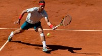 MADRID, SPAIN - MAY 12: Rafael Nadal of Spain plays a backhand to Stanislas Wawrinka of Switzerland during the final match on day nine of the Mutua Madrid Open tennis tournament at the Caja Magica on May 12, 2013 in Madrid, Spain. (Photo by Jasper Juinen/Getty Images)