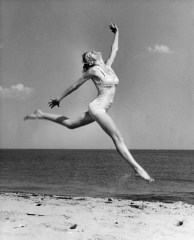 Young woman jumping on the beach da/from www.corbis.com