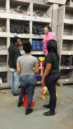Students sort materials at a local service organization.