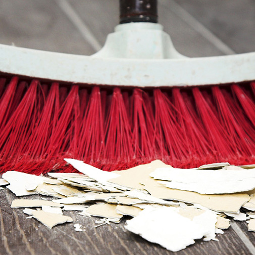 red dry mop cleaning construction debris