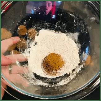 donut hole in powdered sugar
