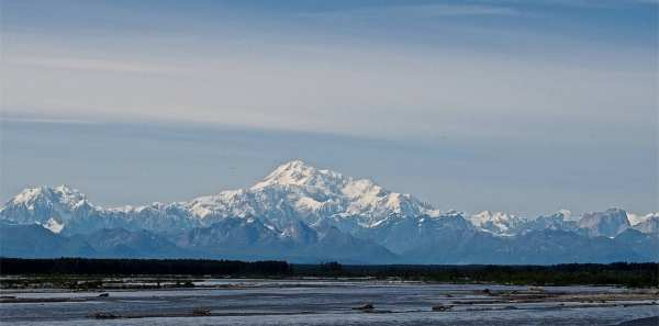 Heading south toward Anchorage, lucky travelers can turn back and see Mt. McKinley lording over the landscape