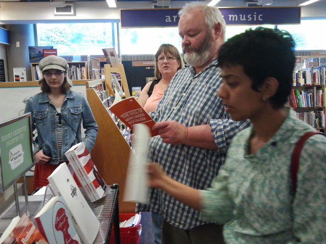 Students from the UW Digital Publishing Certificate class examine books that were printed on the Book Espresso Machine at UW-Seattle Bookstore