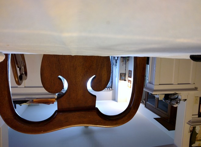 Upside-down photo of chair and ceiling