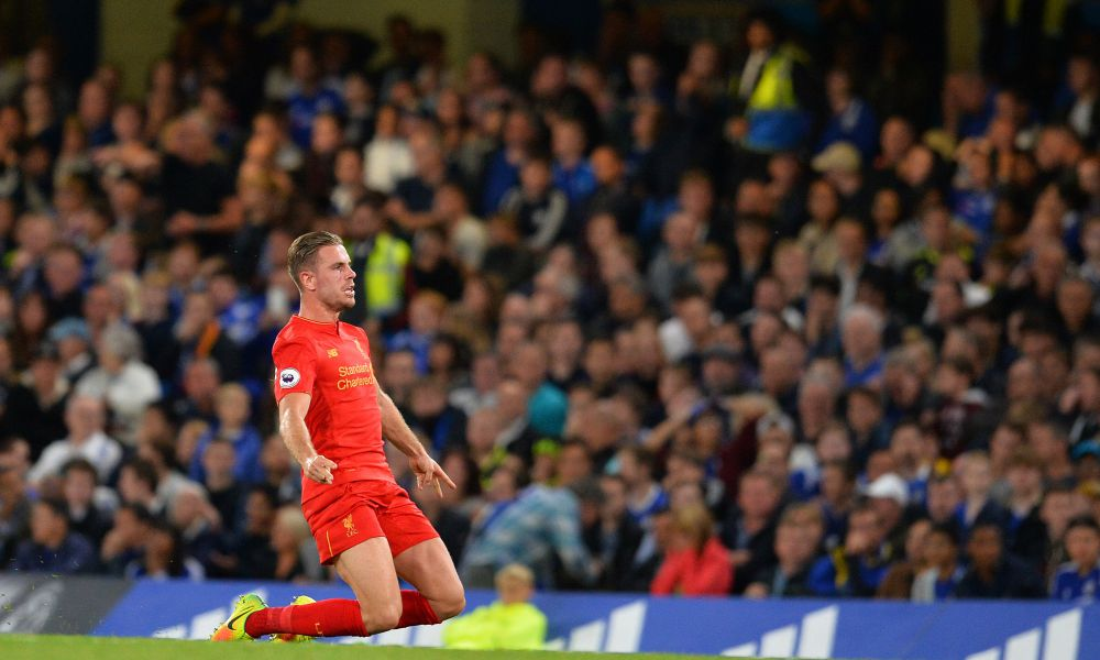 Liverpool's English midfielder Jordan Henderson celebrates scoring his team's second goal during the English Premier League football match between Chelsea and Liverpool at Stamford Bridge in London on September 16, 2016. / AFP PHOTO / GLYN KIRK / RESTRICTED TO EDITORIAL USE. No use with unauthorized audio, video, data, fixture lists, club/league logos or 'live' services. Online in-match use limited to 75 images, no video emulation. No use in betting, games or single club/league/player publications. / GLYN KIRK/AFP/Getty Images ORIG FILE ID: AFP_G821Q