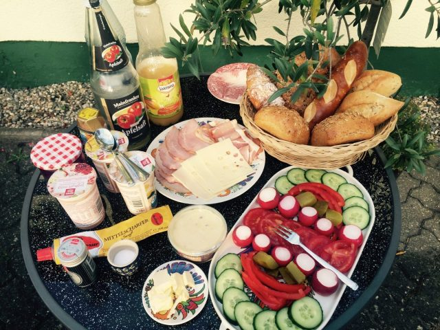 German breakfast,rolls, lunch meats, jelly