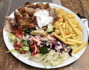 Doener, a Tuerkish street food in Germany, French fries and coleslaw