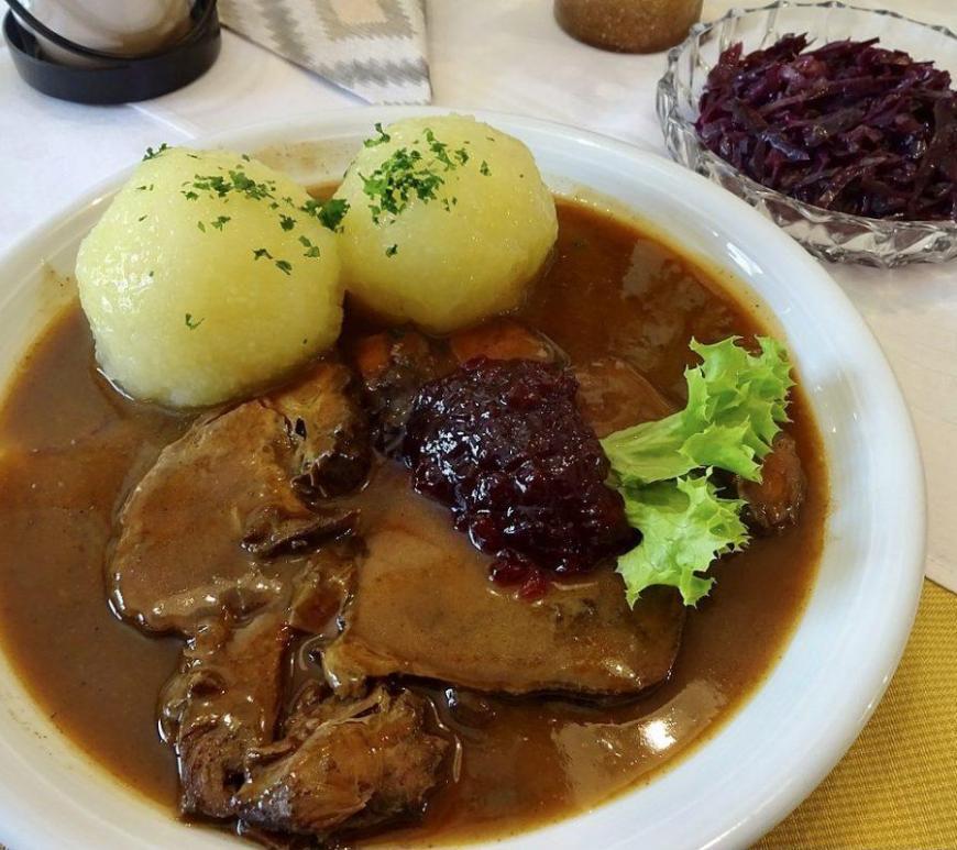 Sauerbraten, potato dumplings and red cabbage