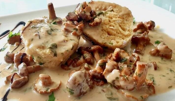 German Semmelknoedel, bread dumplings with chanterelle sauce