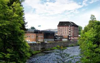 Whiskey distillery beside river scotland