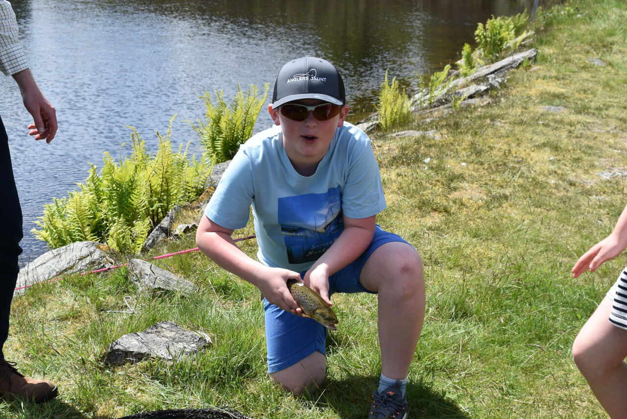 young lad caught trout whilst on holiday in scotland
