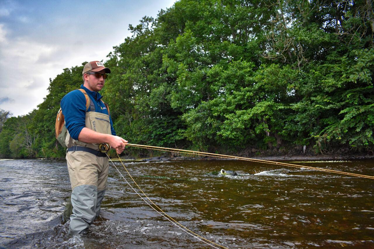 fishing on scottish river during guided fishing trip