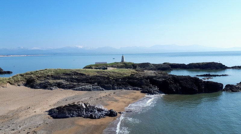 The image shows the back end of Llanddwyn island capturing the lighthouse