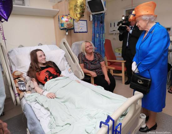 HM The Queen visits with one of the victims of the Manchester sucide bombing.