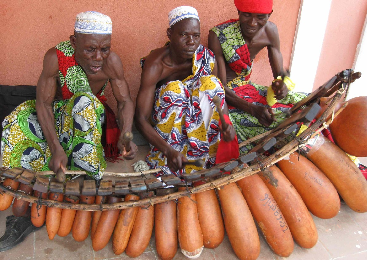 Grupo Marimbeiro playing the marimba inside the museum, a traditional Angolan musical instrument constructed by O Mestre, left.