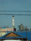 Props for trying- steel mills aren't the prettiest of places, but putting flowers on the stacks is a start... (note, this is not Posco- I'm not sure where it is, actually.  I took a lot of photos from the bus window...)