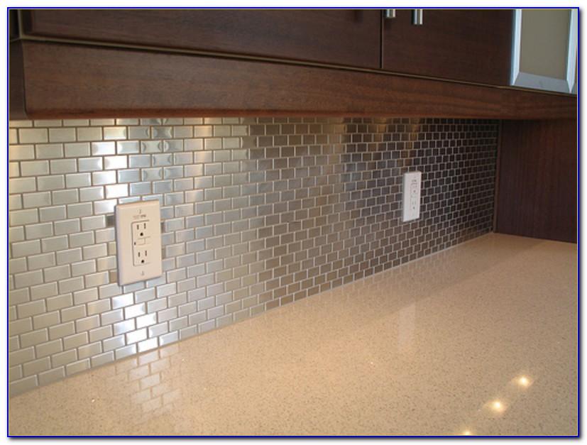 Stainless Steel And White Subway Tile Backsplash