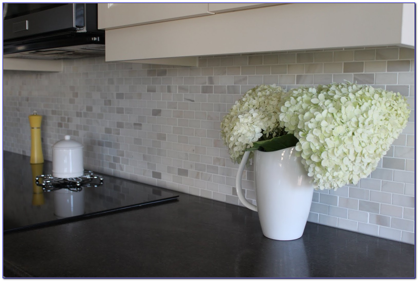 White Mosaic Tile Backsplash
